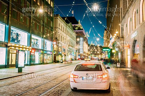 Helsinki, Finland. Taxi Car Parking On Aleksanterinkatu Street. Xmas Christmas Lights Decorations And Festive Illumination. Winter Christmas Xmas Holiday Season