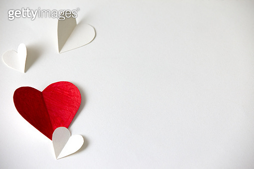 Red and white hearts paper on White paper, valentine's day beautiful background