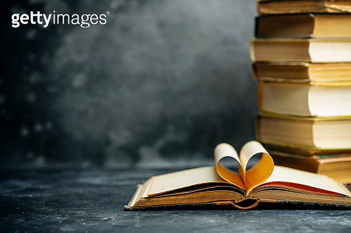 Book study educated. Library and dictionary background. Studying students at universities and colleges, schoolchildren at school and home distance learning concept