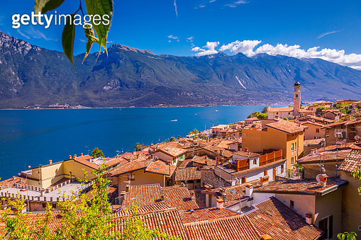 Yachts and sailboats on Lake Garda and Trentino alps above Limone, Italy