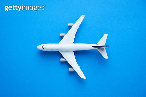 Model airplane on blue pastel color background