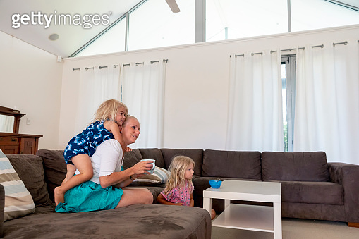 Playful Girls with Mother