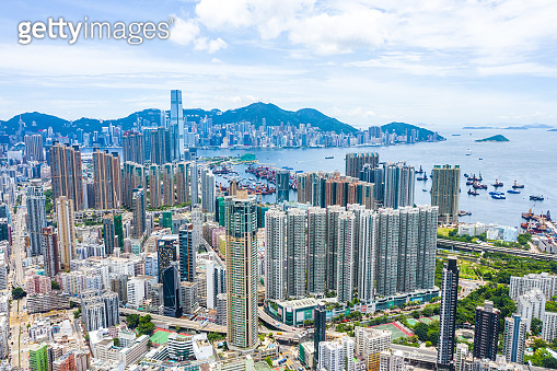 Aerial Kowloon overview sunny day taken by drone, Hong Kong