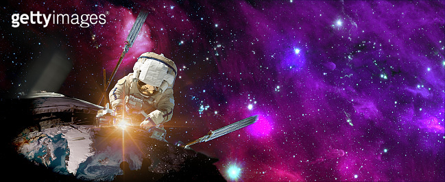Astronaut in outer space over the planet Earth repairs light. Elements of this image furnished by NASA.
