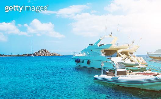 Seascape of few boats on azure water