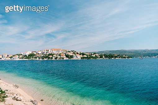 The city of Rogoznica in Croatia. Villas, hotels and houses on the Adriatic coast, azure blue water and sandy beaches.
