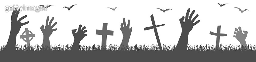 halloween zombie hands with grave stones