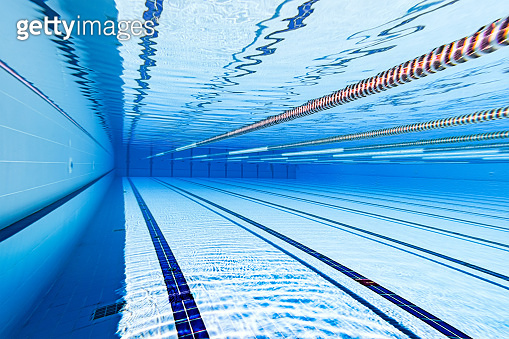 Swimming pool under water background.