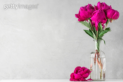 red peony flowers bouquet on white background with copy space. still life. wedding concept. festive background