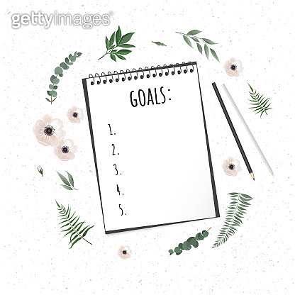 Notebook with wish list on white rustic table, flat lay style. Planning concept.
