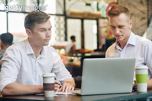 Businessman showing presentation to colleague