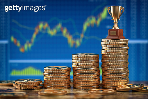 Stock market, investing or forex trading background.  Stacks of golden coins with a cup. Concept of growth and success.