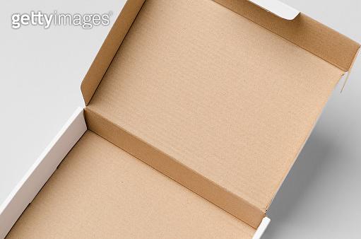 Cardboard postal, mailing box mockup with opened lid, closeup.