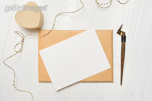 mockup Letter with a calligraphic pen greeting card for Valentine's Day or wedding in rustic style with place for your text. Flat lay, top view