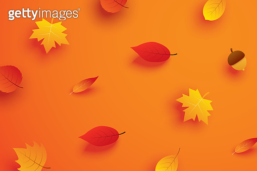 Autumn leaves in paper art style on orange background.