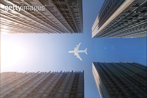 Airplane flying over business