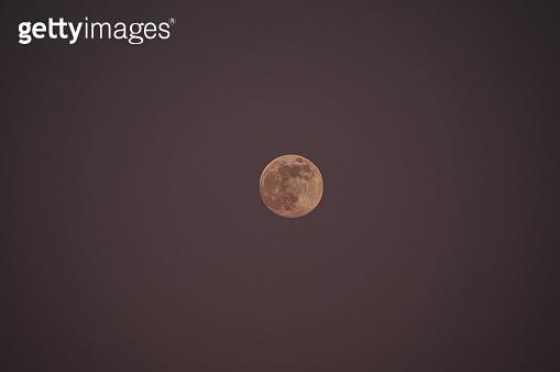 Moon in moody sky