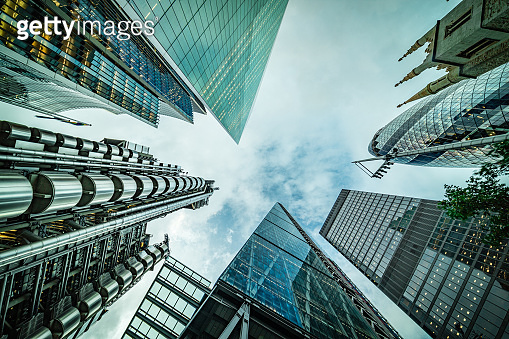 Abstract modern business buildings in London city's financial district - creative stock image