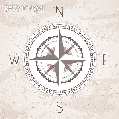 Vector illustration with a vintage compass or wind rose on grunge background.