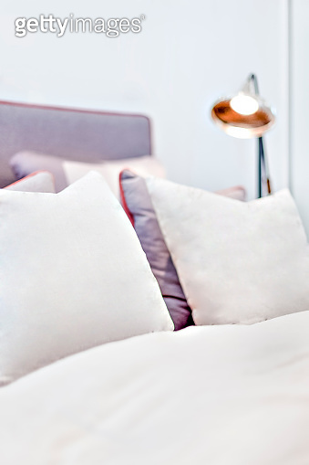 Pillows and blanket with the white color close up