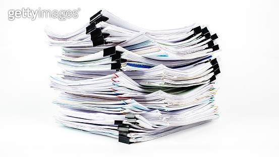 Stacks of business paper files isolated on white background, business report papers, piles of unfinished documents