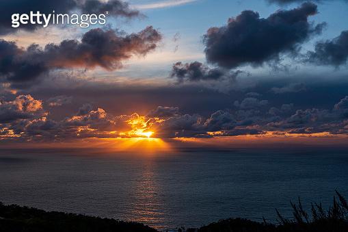Dramatic cloud sunset at Laguna Beach shot from Badlands Park, Southern California