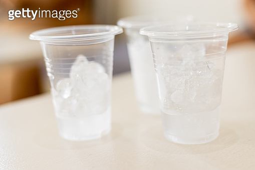 Ice in a plastic glass