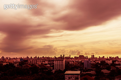 Red sky and city buildings with tiny clouds background - Beautiful sunset sky above clouds with dramatic light