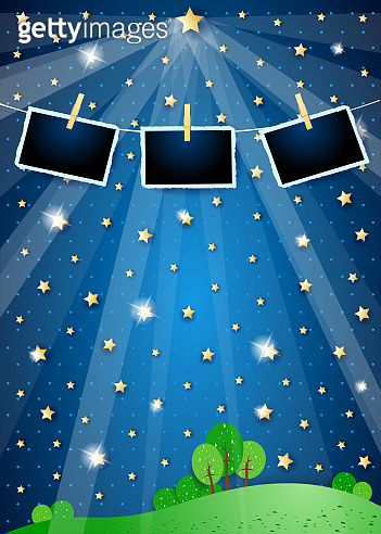 Surreal landscape with star, spotlights and photo frames