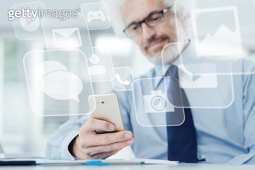 Businessman using a touch screen phone