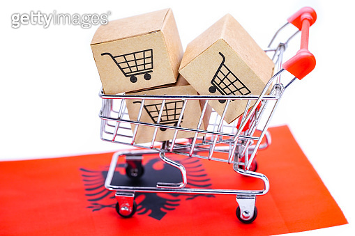 Box with shopping cart logo and Albania flag : Import Export Shopping online or eCommerce finance delivery service store product shipping, trade, supplier concept.