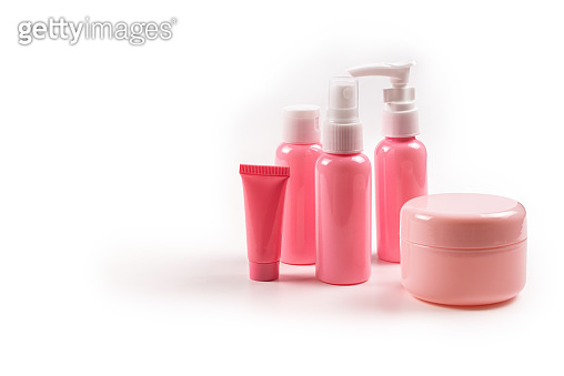 Pink plastic bottles for hygiene products, cosmetics, hygiene products on a white background. Copy space.
