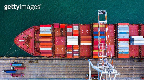 Aerial view container cargo ship at sea port, Business industry commerce global import export logistic transportation oversea worldwide, Sea shipping company vessel.