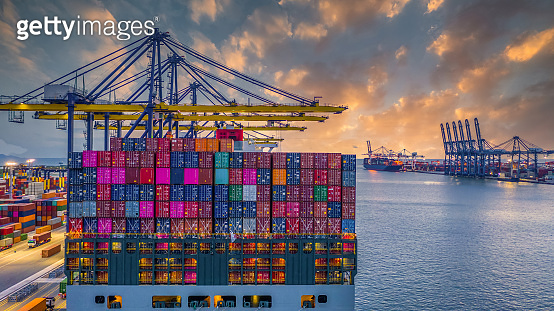 Container cargo ship at industry sea port, import export commerce global business trade logistic and transportation oversea worldwide by container cargo vessel ship boat, Freight shipping maritime.