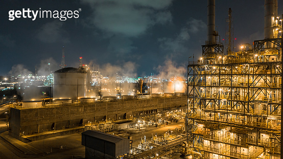 Aerial view industrial view at oil refinery plant form industry zone at night, Refinery plant or petrochemical factory industrial, Ecosystem and healthy environment ecology concept.
