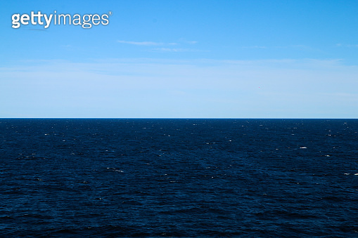 The Picture from a ferry between Sweden and Finland. The contrast between the bright sky and dark water.