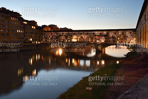 The Famous Old Bridge over Arno river, illuminated on the occasion of Firenze Light Festival, entitled in homage to Dante