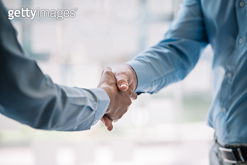 Business people shaking hands congratulations and confirmed the agreement and the investment partner.