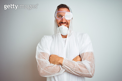 Painter man wearing professional worker equipment protection over isolated background happy face smiling with crossed arms looking at the camera. Positive person.