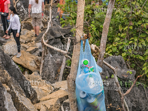 Garbage in plastic bag pas on mountain peak of Pha Ngeun in vangvieng City Laos.Vangvieng City The famous holiday destination town in Lao.