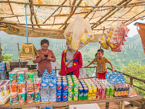 Unacquainted Local people shop on the top of Pha Ngeun in vangvieng City Laos.Vangvieng City The famous holiday destination town in Lao.
