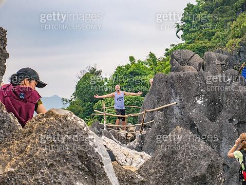 Unacquainted tourist on mountain peak of Pha Ngeun in vangvieng City Laos.Vangvieng City The famous holiday destination town in Lao.