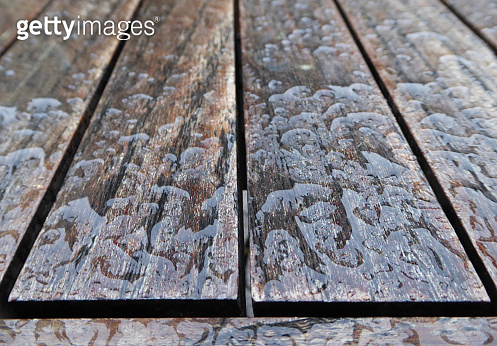 Wet wooden table surface after the rain