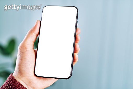 Woman holding and touching blank screen template smart phone. Smart phone screen is empty with clipping path.