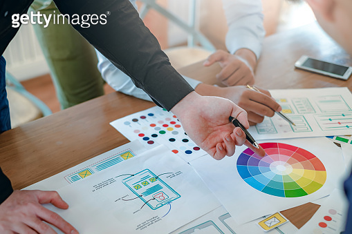 Creative web designers and applications work together in the office.