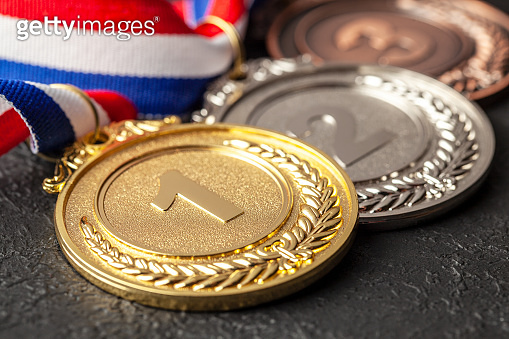 Gold, silver and bronze medal with ribbons