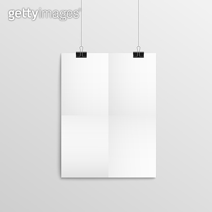 Blank piece of paper hanging on wall with black binder clips, empty mockup