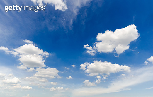 beautiful blue sky and white fluffy cloud horizon outdoor for background.