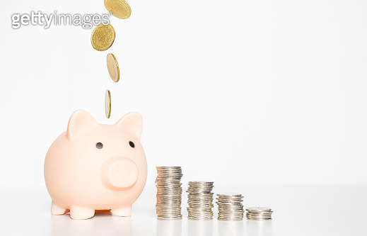 business financial money saving concept. coin falling down with coin stacking on white background. finance investment success.