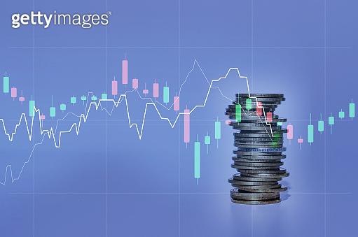 double exposure of city with row of coin stack with growth stock chart and graph progress report for business investment finance banking and money saving concept.